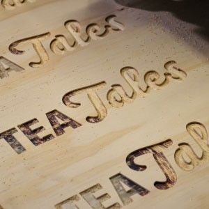 Tea tales routed out of wood